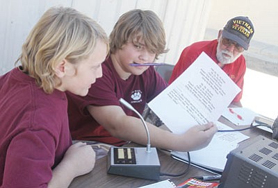 From left to right, Exzavier Clubb, 12 (left), Justin Foran, 13, and Dan Miller work on operating a ham radio last week as part of student enrichment activities at Kingman Middle School. The next intercession is scheduled for Dec. 21-Jan.1. (JC AMBERLYN/Miner)