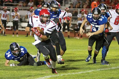 RYAN ABELLA/Miner<BR> Lee Williams' Paul Giglio slices and dices his way through the Kingman Academy defense Friday night at Kingman High School. Giglio rushed for 167 yards and a touchdown in the Vols' 38-21 win.
