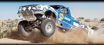 The Napa Chassis 7155 truck cuts through the desert at a recent SNORE race. The 46th Annual NAPA Auto Parts SNORE 250 takes place Saturday at the Route 66 Motorsports Park. (Courtesy/snoreracing.net)