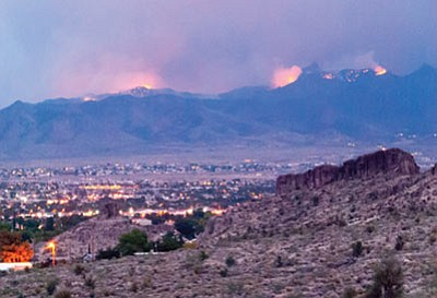 The Bureau of Land Management and Arizona Game and Fish Department will team up in the upcoming weeks to conduct a pair of prescribed burns in the Hualapai Mountains, in part to lessen the risk of dangerous wildfires, such as the Dean Peak Fire that erupted in the summer of 2013, above.  (File photo)