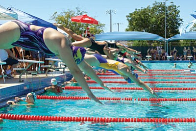The final high school swim meet in Kingman takes off at 4 p.m. today in the Del E. Webb Wellness Center featuring Kingman, Kingman Academy, Bullhead City MALC and San Luis.  Above, swimmers embarked in the girls 50-yard freestyle Sept. 19 at Centennial Park. (RYAN ABELLA/Miner)