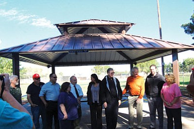 Mayor Richard Anderson and other city officials and employees, along with employees from McKee Foods, held a ribbon cutting for a new pavilion at Centennial Park Wednesday. (DOUG McMURDO/Miner)