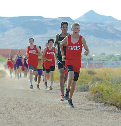 Lee Williams's Brendon Allred leads the pack at the Kingman High Multi Sept. 23. Allred and his teammates race at the Division III, Section II championship race with a berth at state on the line today in Holbrook. (RYAN ABELLA/Miner)