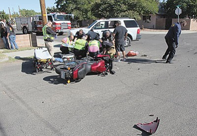 Responders tend to the accident victim. (KPD/Courtesy)