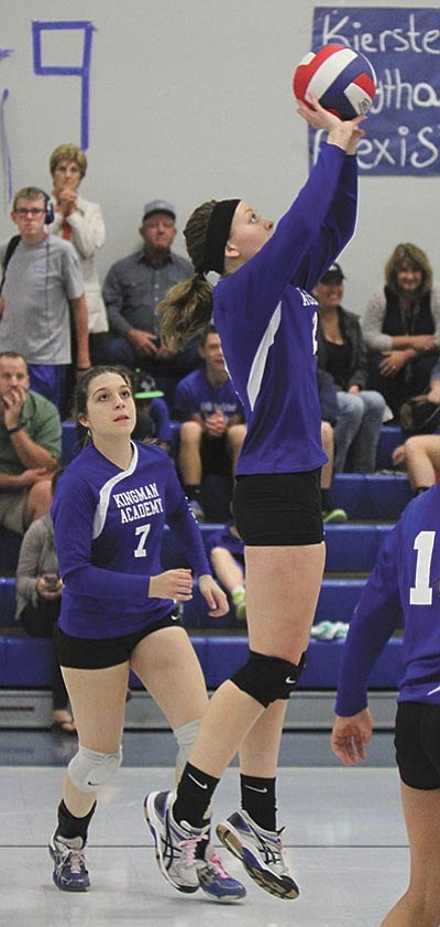 Kingman Academy senior Reagan Haynes goes for a quick set Thursday against Gila Bend. (JC AMBERLYN/Miner)