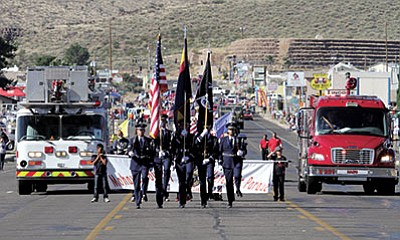 The Color Guard leads the Kingman Veterans Day Parade in 2014. (JC AMBERLYN/Miner)