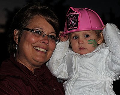 JC AMBERLYN/Miner<br>Laurie and Madyson DeVries, 2, getting into the spirit at the Go Pink Block Party.