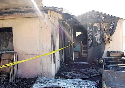 Dolan Springs Baptist church was damaged Sept. 26 by what investigators are calling arson. Mount Tipton Community Church burned completely. (DOUG McMURDO/Miner)