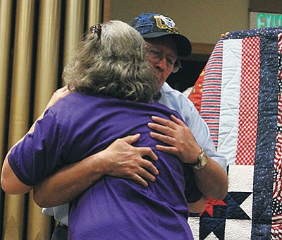 JC AMBERLYN/Miner<BR>Ken King, who served 25 years in the U.S. Air Force, hugs a Kingman Quilter's Guild member Saturday as he receives his quilt.