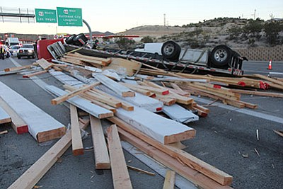 A tractor-trailer dumped its load on Beale Street Thursday, blocking traffic. (Courtesy)