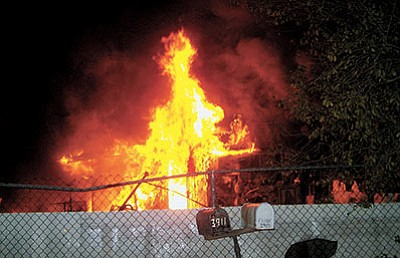 A house overflowing with hoarded items and an agitated crowd impeded firefighters Wednesday.  (Courtesy)