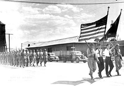 Army soldiers in a parade on Front Street at the Kingman Santa Fe Railroad Depot, 1944. (MOHAVE MUSEUM/Courtesy)