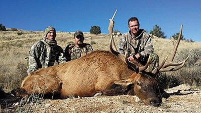 Rink Gordon, Fred Moore and Keith Walker are happy with the bull that Walker got on his muzzleloader hunt in Unit 10. (Courtesy)