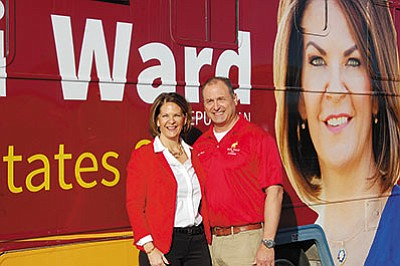 Kelli and Mike Ward stand by her campaign RV Wednesday morning outside of Mohave County Republican Party headquarters on Stockton Hill Road. (DOUG McMURDO/Miner)