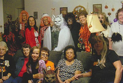 "Xi Beta Phi: The chapter of Xi Beta Phi of Beta Sigma Phi celebrated their Halloween meeting at the home of Faye Rainey. The theme created by President Rene Fields was ""werewolves."" Joyce Onnen won the best costume (top row, sixth from the left). The sisters are preparing for their Christmas Service Project by assisting a family with children. A budget has been set for service projects. The sisters reach into their pockets also with private donations."