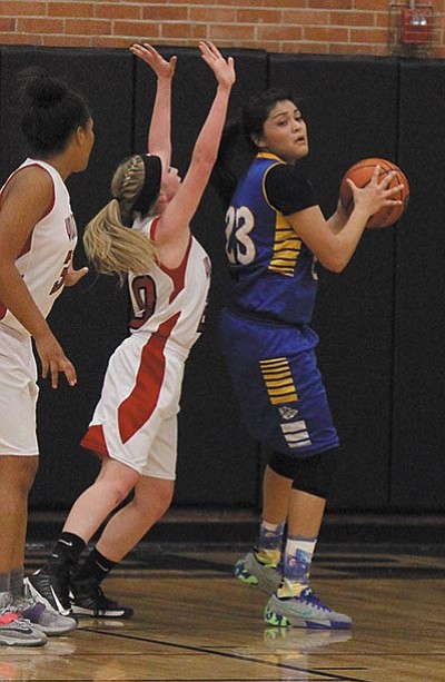 JC AMBERLYN/Miner<BR> Kingman's Desirae Gonzalez looks for an opening against Lee Williams' Jackie Millim and Chania Scott, left, on Nov. 24. Gonzalez scored 75 points in two games at the River Valley Shootout Friday.