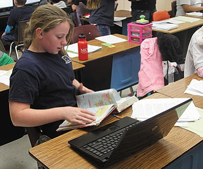 Mya Powell, 10, works on skills that will help her pass her ATI Galileo test Tuesday in Scott Taylor's fifth-grade class at Manzanita Elementary School. Arizona student results on the new standardized test showed there's plenty of work to do, although KAOL test-takers did relatively well. (JC AMBERLYN/Miner)