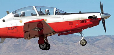 The pilot of this T-6B Texan II trainer aircraft was taking part in touch-and-go maneuvers on the Kingman Airport runway on Feb. 25. (RYAN ABELLA/Miner)