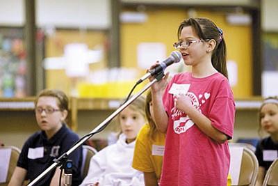 Lita Baynard competes at the Hualapai Elementary School spelling bee on Friday. (RYAN ABELLA/Miner)