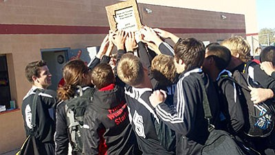 The Lee Williams High boys soccer team took a moment to celebrate after winning the Mohave County Boys Soccer Tournament on Saturday. The Vols returned to the regular season with a 3-2 overtime win over MALC Monday at LWHS. (Courtesy)