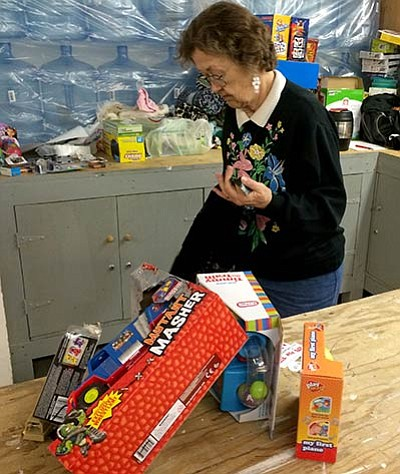 HUBBLE RAY SMITH/Miner<BR> Wanda Hull spends a couple days a week volunteering for Toys for Tots, unloading toys and filling bags for Christmas joy.
