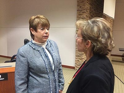 Sue Donahue, left, talks with Mohave County Supervisor Hildy Angius after the board appointed Donahue to fill the state Senate seat vacated by Kelli Ward. Donahue is a former administrative assistant for Supervisor Buster Johnson. (HUBBLE RAY SMITH/Miner)