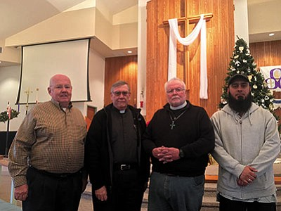 RYAN ABELLA/Miner<BR> Clergymen representing four different faith communities are coming together to hold a service for peace in January. From left: Pastor Ray Christenson, Father Leonard Walker, Father Philip Shaw, and Imam Umar Farooq Mahmood.