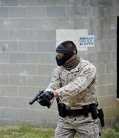 Courtesy<BR> A Marine Corps police officer moves at the ready position during active shooter training in Quantico, Va., in this April 22, 2014 photo.