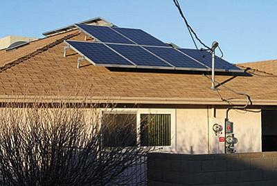 JC AMBERLYN/Miner<BR> A rooftop solar installation in Kingman.