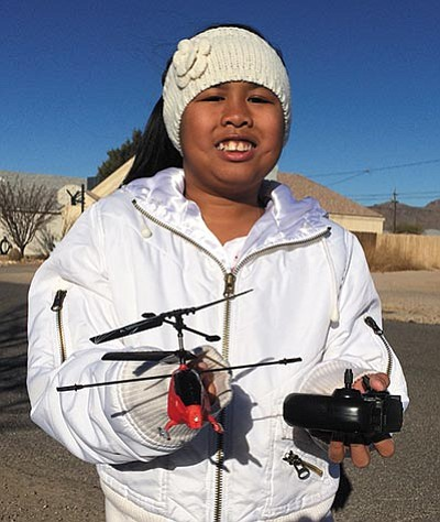 HUBBLE RAY SMITH/Miner<BR> Abigail Atibagos shows the remote-controlled helicopter she lost in high winds. Cody Davis of the Miner found it, and a brief story with a photo of the helicopter led to the toy being returned to Abigail.
