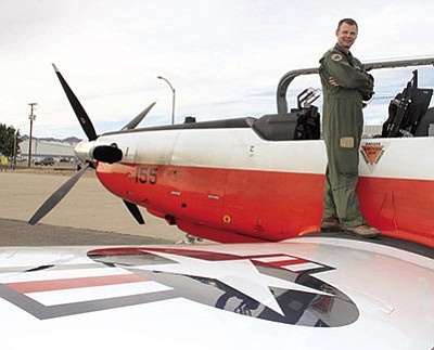 Lt. Cmdr. David Flowers is pictured in January 2015 with his T-6B Texan 2 plane. (JC AMBERLYN/Miner)