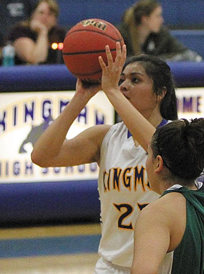 Kingman High's Desirae Gonzalez attempts a free throw Dec. 8 against Mohave. Gonzalez looks to reach 2,000 career points when the Lady Bulldogs host River Valley at 5:30 p.m. today. (JC AMBERLYN/Miner)