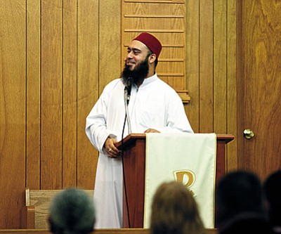 RYAN ABELLA/Miner<BR> Imam Umar Farooq Mahmood discusses a verse from the Qur'an during a joint peace service held on Friday evening.