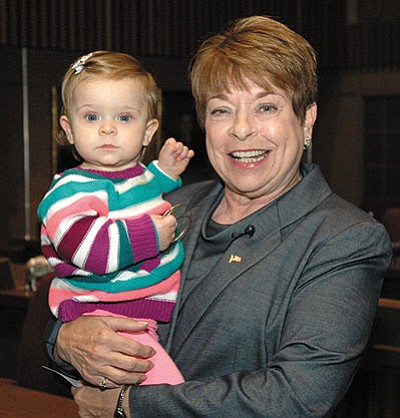 Howard Fischer/Capitol Media Services<BR> New state senator Sue Donahue is pictured with granddaughter Maya Sinay during Donahue's Thursday's swearing-in ceremony in Phoenix. Donahue replaces Kelli Ward, who is running for the U.S. Senate.