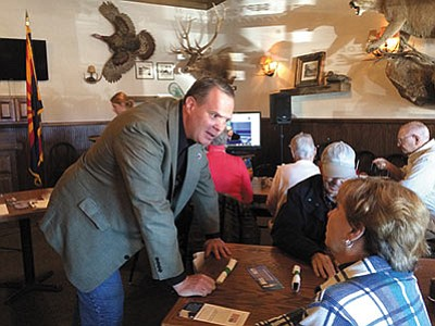Alex Meluskey, Republican candidate for U.S. Senate, speaks with members of the Conservative Republican Club of Kingman before Monday's meeting. (HUBBLE RAY SMITH/Miner)<br /><br /><!-- 1upcrlf2 -->