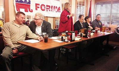 From the left are Mohave County Sheriff candidates John Gillette, Joe Archie, John Plough, Cori Merryman and Doug Schuster. Mohave Republican Forum President Laurie Voss Barthlow, standing, moderated the discussion. (DOUG McMURDO/Miner)