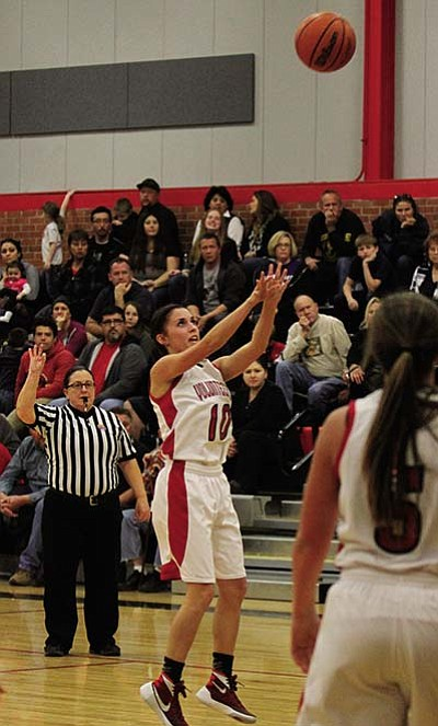 JC AMBERLYN/Miner<BR> Lee Williams High's Madi Arave releases a 3-pointer during the Lady Vols' 33-29 win over Lake Havasu Thursday. Lee Williams backed that win up with a triumph over Youngker in overtime, 50-46.