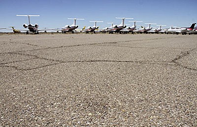 The normally flat south field of the Kingman Airport, pictured in 2013 with several cracks and pock marks that worsen after rainfall. (JC AMBERLYN/Miner)