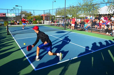 Pickleball, a racquet sport similar to tennis but played on a smaller court, is catching on with more than 200,000 players worldwide, according to the USA Pickleball Association. (CHUCK RODERIQUE/USA Pickleball Association)