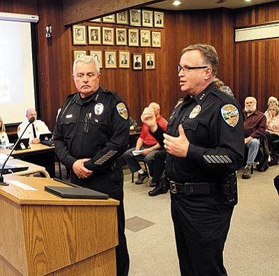 DOUG McMURDO/Miner<BR> Kingman Police Chief Bob DeVries, left, and Deputy Chief Rusty Cooper address the City Council at Tuesday's meeting.