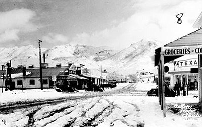 This 1935 photo shows Chloride after snowstorm. Winter weather two years later would claim two lives and set a record low temperature for Kingman. (GALLUP STUDIO, MOHAVE MUSEUM OF HISTORY AND ARTS/Courtesy)