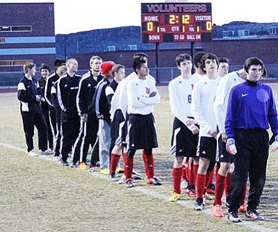 SHAWN BYRNE/Miner<BR> The Lee Willaims High boys soccer lined up for introductions Jan. 20 against River Valley at LWHS. The Volunteers have advanced to the Division IV state tournament for the first time in school history.