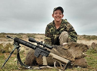 Laura Borden shows a javelina that she got on a recent Juniors only hunt in Unit 18B. Borden took the pig with one shot at 185 yards. (Special to the Miner)