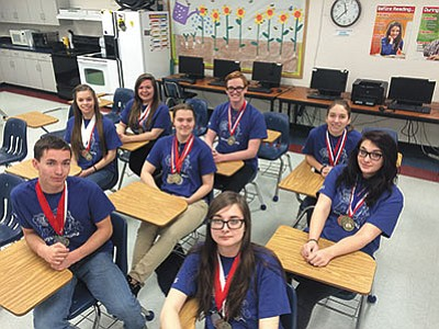 Kingman Academy High School recently won the regional academic decathlon competition, defeating eight other schools and advancing to the state tournament March 11-12. Front row (left to right): Jacob Appleby and Anna Samel; middle row (l-r): Corytha Gastineau, Stasi White and Megan Radcliffe; back row (l-r): Emme Compton, Tyler Radcliffe and Alexis Whalen. Not pictured: Peter Kile. (HUBBLE RAY SMITH/Miner)