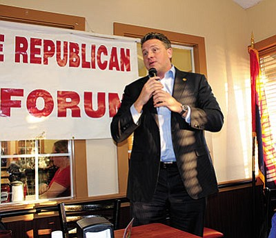 State Republican Party Chairman Robert Graham didn't let jet lag prevent him from rallying the troops at Wednesday's Mohave Republican Forum. (DOUG McMURDO/Miner)
