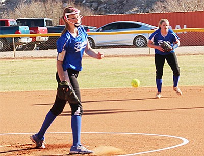 Maryssa Edwards delivers a pitch for Kingman Academy in the first inning of Monday's loss to Mohave, 9-3. Edwards threw a complete game, giving up three earned runs, but the Lady Tigers' defense made seven errors behind her. (SHAWN BYRNE/Miner)