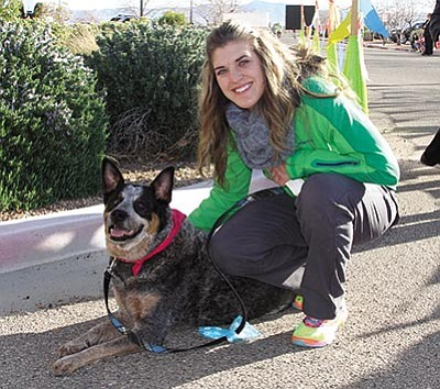 JC AMBERLYN/Miner<BR>Dr. Taylor Williams and Lizzie the Australian cattle dog are all smiles at the race.