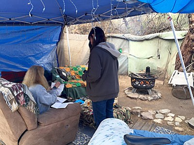 A Catholic Charities worker talks with a woman at a homeless camp in Mohave County. (Courtesy)