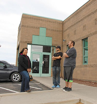ALAN CHOATE/Miner<br> From left, Maria Lancaster, Michael Mertl and Jeffrey Lancaster wait outside the Kingman MVD office. They'd been there about an hour and were expecting to wait a little longer for their number to be called.