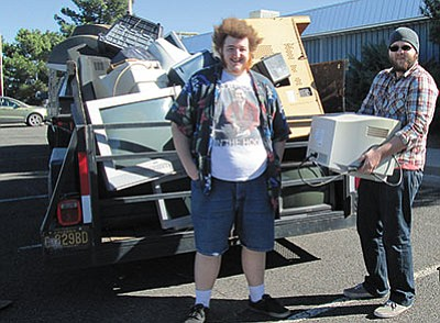 Devon Kinney, left, and Tim Gardner load a trailer from last year's tech recycling event. (Courtesy)